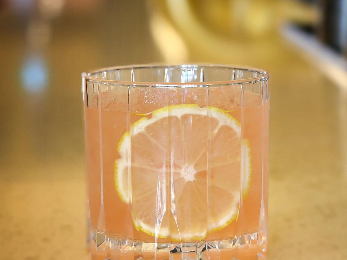 pink cocktail with citrus slice
