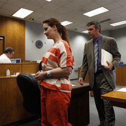 Gypsy Willis, former girlfriend of Martin MacNeill, listens to her attorney, John Easton.