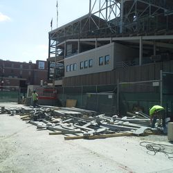 2:03 p.m. Various parts of the right-field video board lying on Sheffield -