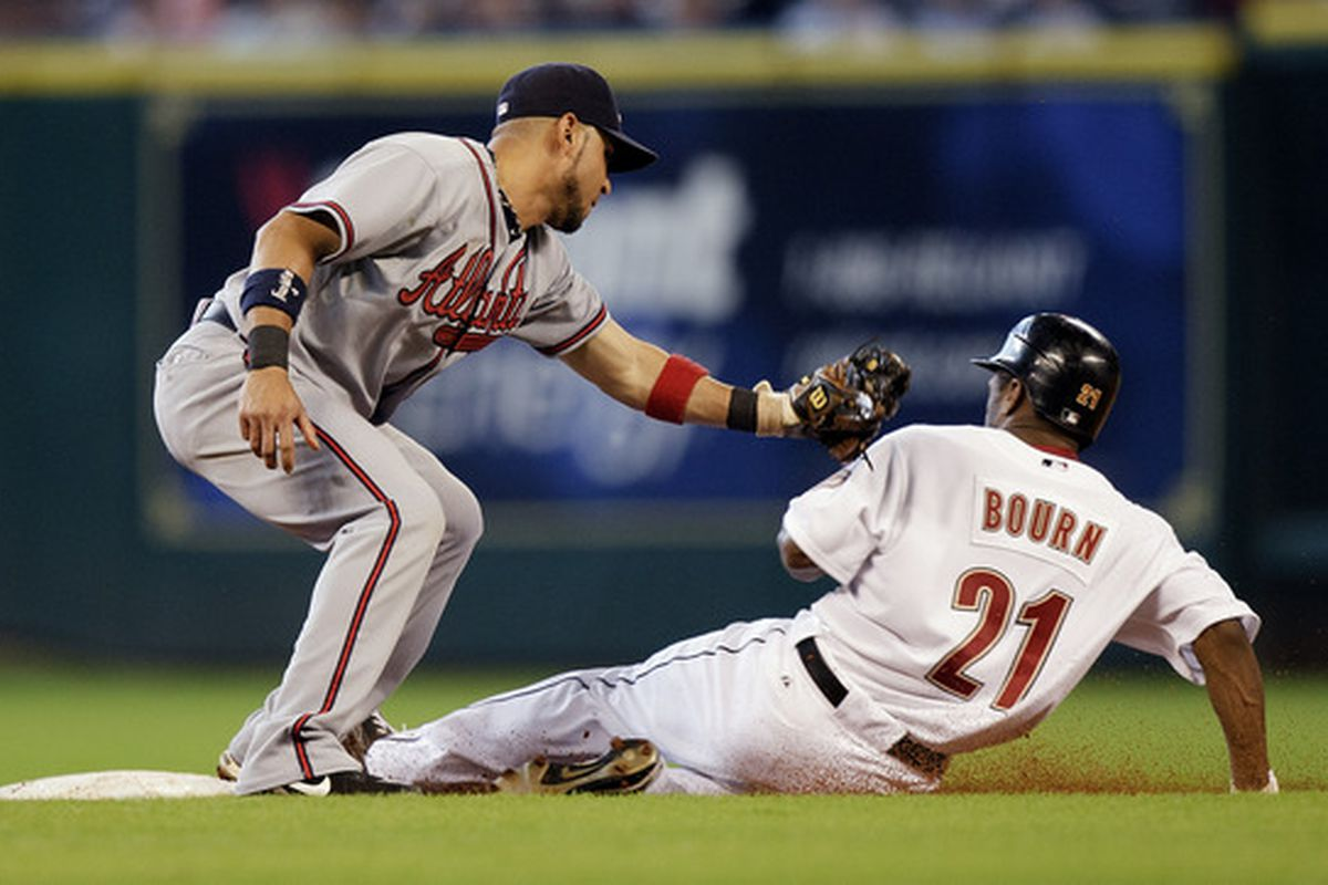 HOUSTON - AUGUST 11:  Michael Bourn #21 of the Houston Astros steals second base as shortstop Alex Gonzalez #2 ofthe Atlanta Braves applies the tag at Minute Maid Park on August 11 2010 in Houston Texas.  (Photo by Bob Levey/Getty Images)