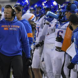 Boise State coach Bryan Harsin watches the team play Utah State during the first half of an NCAA college football game Saturday, Nov. 23, 2019, in Logan, Utah.