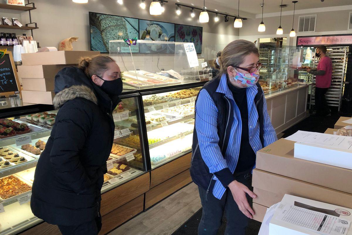 Dobra Bielinski, owner of Delightful Pastries, looks for a customer's paczki order Tuesday morning.