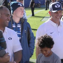 BYU running backs coach Reno Mahe, left, and offensive coordinator Ty Detmer smile while talking following the Cougars' 41-20 win over San Jose State on Saturday, Oct. 28, 2017, at LaVell Edwards Stadium in Provo.