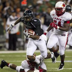 Hawaii running back Will Gregory runs through the Lamar defense during the second quarter of the NCAA game between the Lamar and Hawaii, Sept. 15, 2012 in Honolulu.