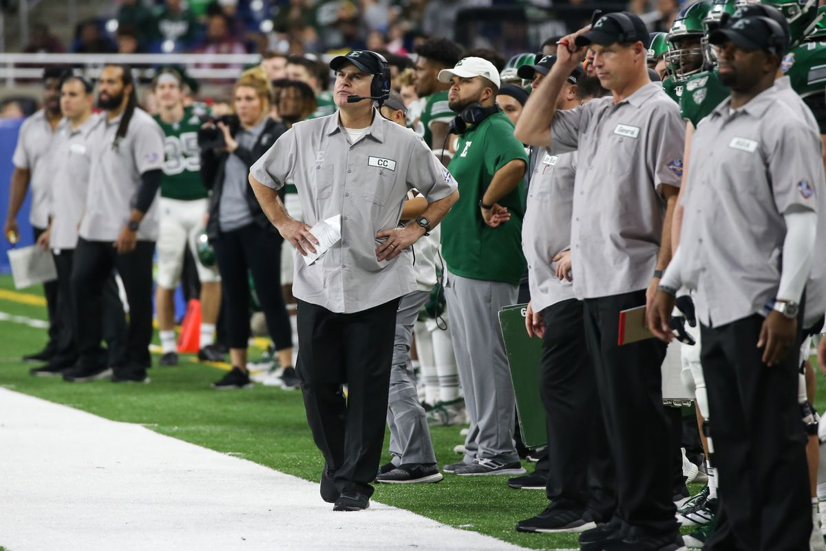 Eastern Michigan Eagles head coach Chris Creighton, center, looks at the scoreboard during the Quick Lane Bowl game between the Pitt Panthers and the Eastern Michigan Eagles on December 26, 2019 at Ford Field in Detroit, Michigan.