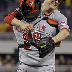 Cincinnati Reds starting pitcher Homer Bailey, right, celebrates with Cincinnati Reds catcher Ryan Hanigan (29) after getting the final out of a no-hitter in a baseball game against the Pittsburgh Pirates in Pittsburgh Friday, Sept. 28, 2012. The Reds won 1-0.
