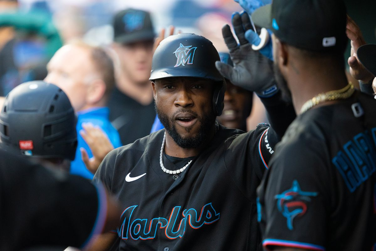 Miami Marlins center fielder Starling Marte (6) is greeted after hitting a two RBI home run against the Philadelphia Phillies during the first inning at Citizens Bank Park.