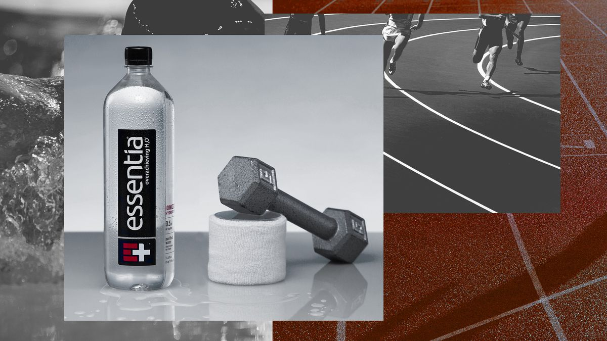 An Essentia water bottle with a weight and workout gear.