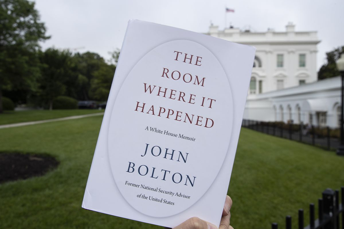 """In this June 18, 2020, file photo a copy of """"The Room Where It Happened,"""" by former national security adviser John Bolton, is photographed at the White House in Washington."""