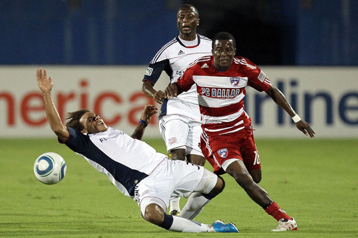 FRISCO TX - SEPTEMBER 22:  Midfielder Marvin Chavez #18 of FC Dallas dribbles the ball past Kevin Alston #30 of the New England Revolution at Pizza Hut Park on September 22 2010 in Frisco Texas.  (Photo by Ronald Martinez/Getty Images)