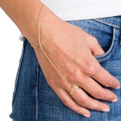 "<b>Joolz by Martha Calvo</b> V Hand Chain Bracelet, <a href=""http://www.revolveclothing.com/joolz-by-martha-calvo-v-hand-chain-bracelet-in-gold/dp/JOOL-WL5/?&d=F&currency=USD&mkwid=5mcYvVYH|pcrid|54529711811&adgroups={adwords_groups}&adlabel={adwords_labe"