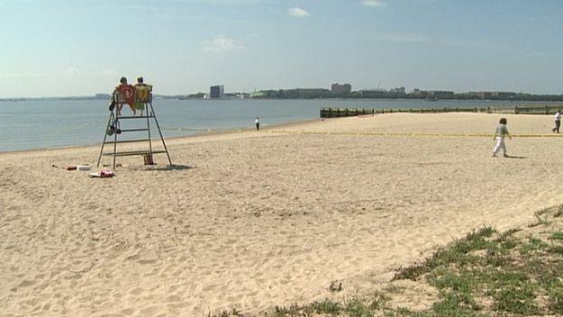 A sandy beach with a lifeguard chair.