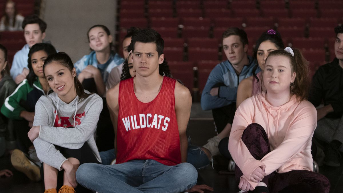 Nini, EJ, and Ashlynn sit on the floor of the theater before auditions