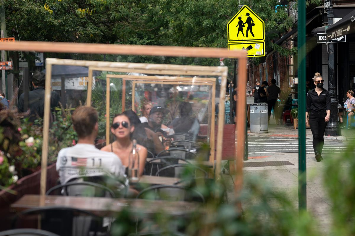 People enjoy outdoor dining along Orchard Street in the Lower East Side, Sept. 25, 2020.