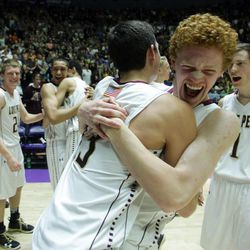 Lone Peak's Dylan Hedin, right, and Zach Frampton celebrate their win over Alta after the 5A State Championship game in Ogden Saturday, March 2, 2013.