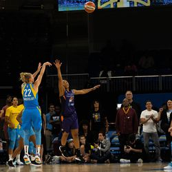 Courtney Vandersloot knocks down a three over Briann January early in the game.