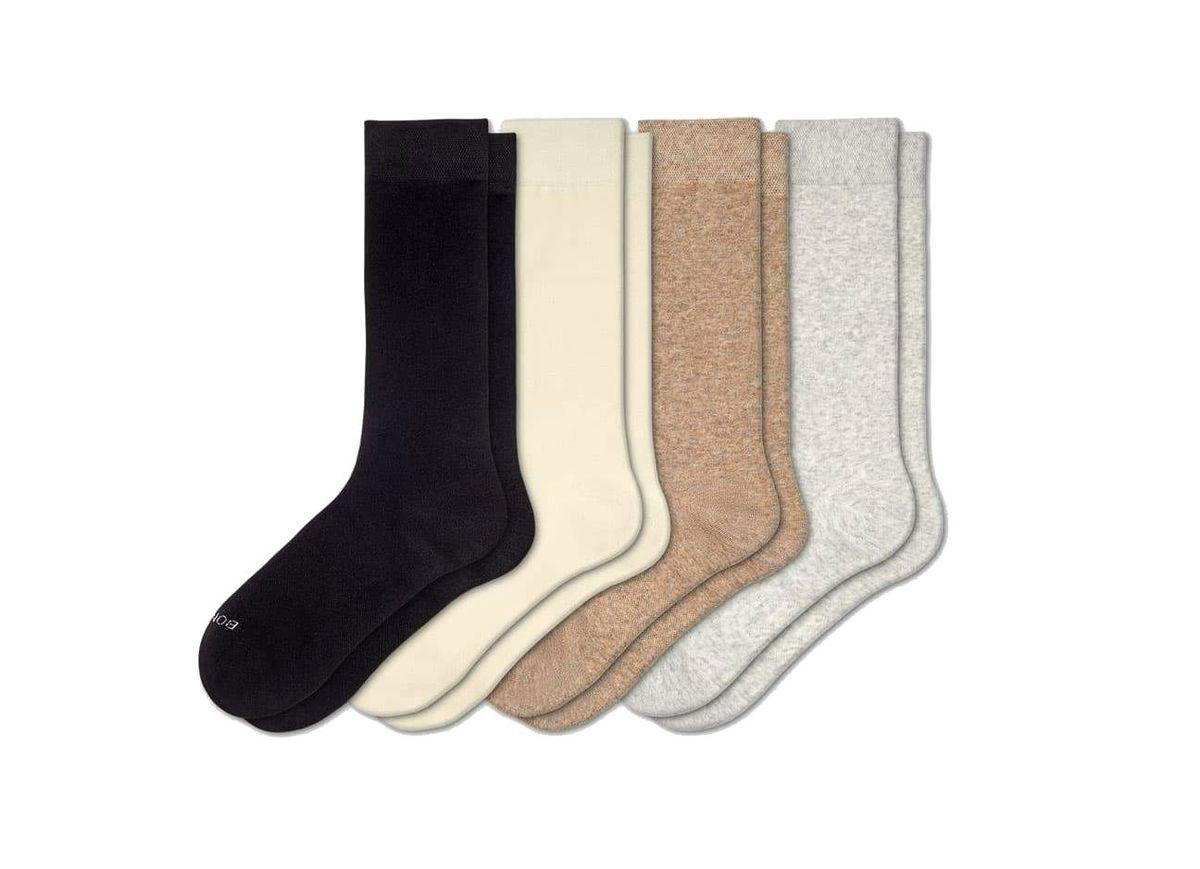 Four neutral-colored women's socks