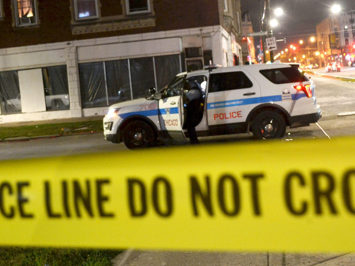 Police investigate a shooting about 11:30 p.m. Saturday, August 18, 2018 in the 7800 block of South Paulina Ave in Chicago. | Justin Jackson/ Sun-Times
