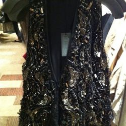 This pretty LOVE vest is $125