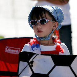 Ella Stohl, 6, of South Jordan watches the Days of '47 Parade in Salt Lake City Saturday.