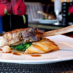 Milk-Fed Veal Chop with Anna Potatoes, Sautéed Spinach and Truffle Veal Jus
