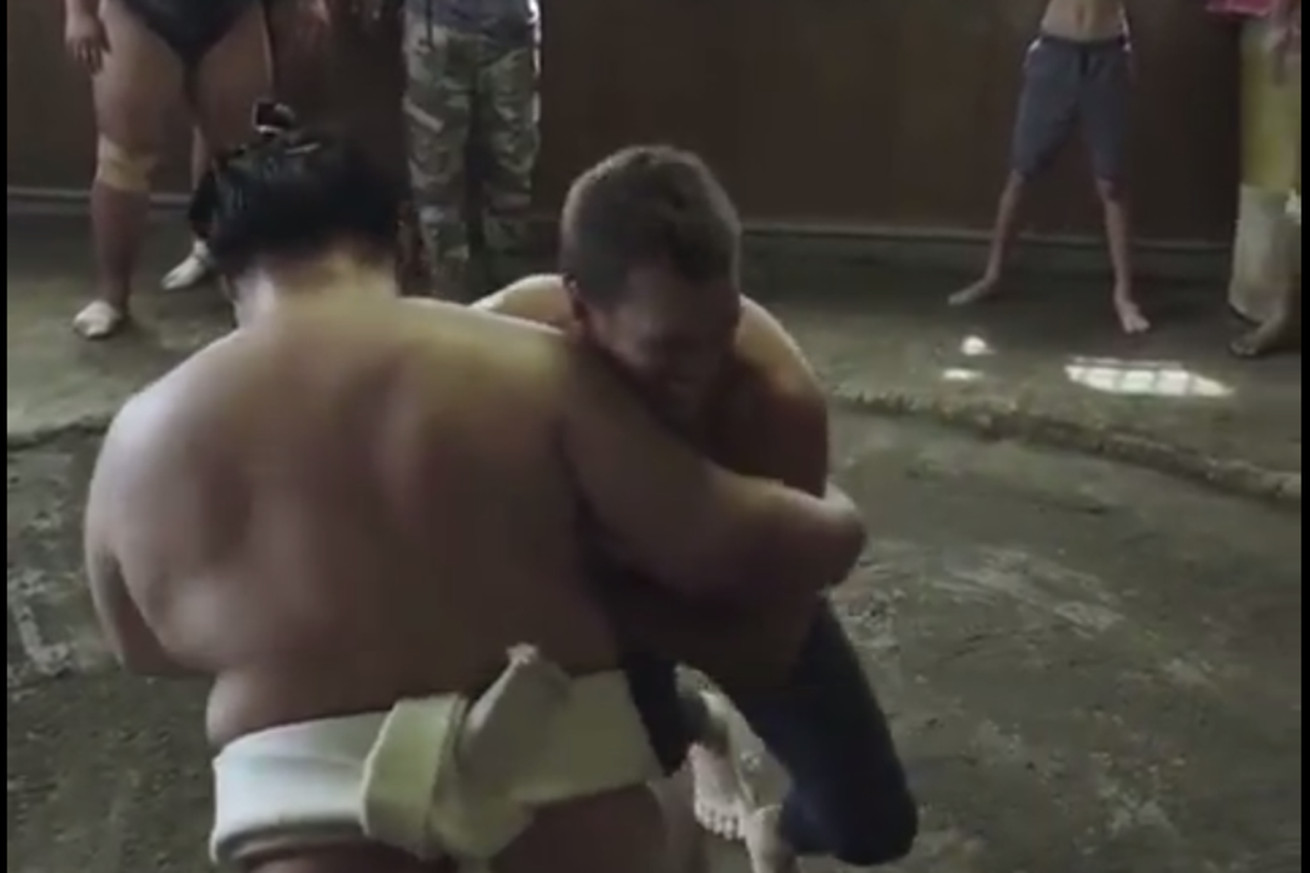 Midnight Mania! Tom Brady gets stopped cold by Sumo wrestler