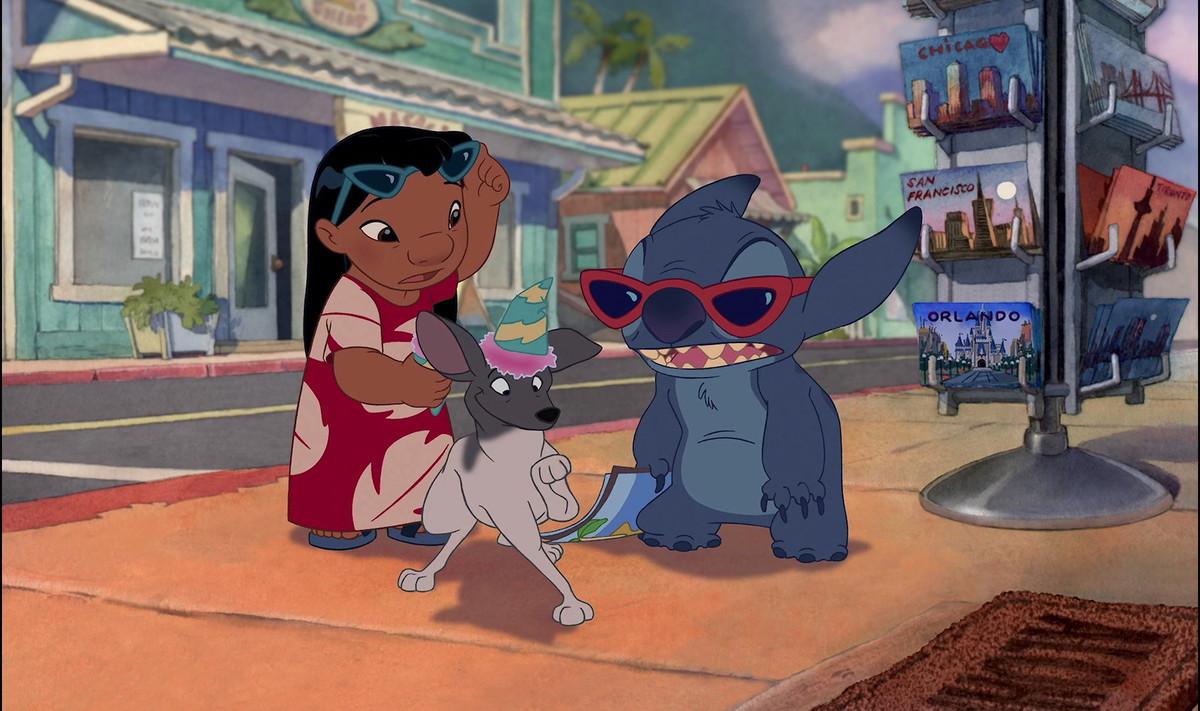 lilo and stitch wearing sunglasses and regarding a small dog