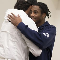 Olympus High School football player Brach Davis, right, is congratulated after signing with BYU at Olympus High in Holladay, Utah, on Wednesday, Dec. 20, 2017.