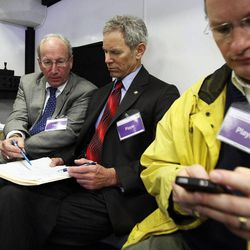 Mayor Ralph Becker signs a mock disaster declaration at the temporary emergency operations center for Salt Lake City at Washington Square during The Great Utah ShakeOut, Tuesday, April 17, 2012. At left is Ed Rutan, city attorney. At right is Salt Lake City Council Chair Soren Simonsen.
