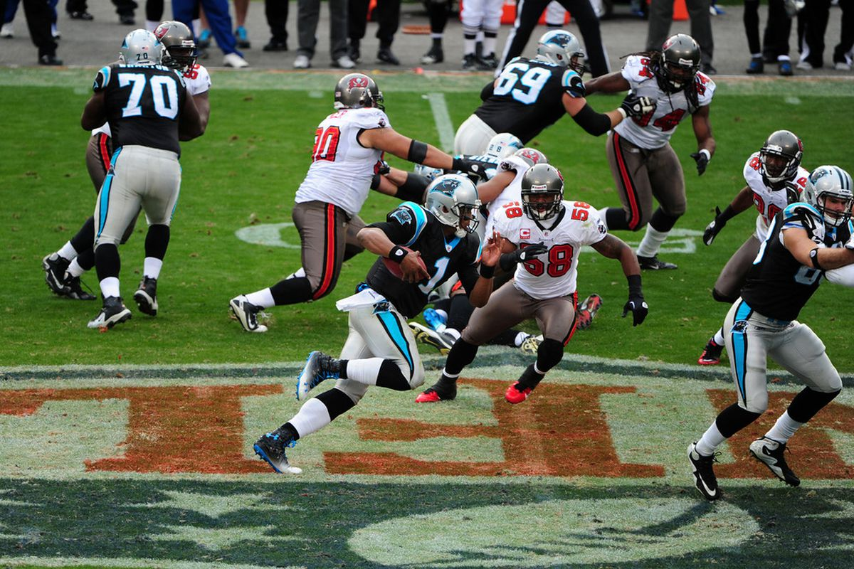 CHARLOTTE, NC - DECEMBER 24: Cam Newton #1 of the Carolina Panthers runs for a 49 yard touchdown against the Tampa Bay Buccaneers at Bank of America Stadium on December 24, 2011 in Charlotte, North Carolina  (Photo by Scott Cunningham/Getty Images)