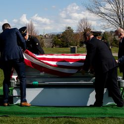 Larkin Mortuary employees and military personnel carry Richard Ragar's casket to his burial site for his funeral service at Larkin Sunset Gardens in Sandy on Monday, April 20, 2020. The World War II veteran lived in Alpine with his wife before moving to Arizona. He passed away after being hospitalized alone for about a month at age 93 during the coronavirus pandemic.
