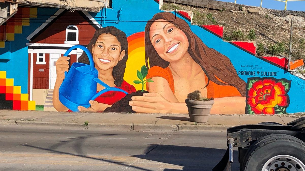 Anne Heisler says the skills she picked up decorating cakes for about 15 years help with her art career, which includes this mural painted on a viaduct at 47th Street and Archer Avenue in Archer Heights on the Southwest Side.