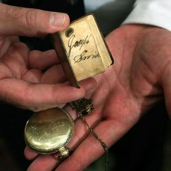 The pocket watch and thumb Bible belonging to Joseph Smith is on display at the Independence Through History Museum in the Grand America in Salt Lake City on Friday, July 5, 2013.