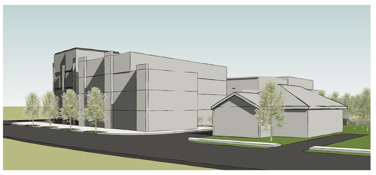 A rendering of a gray building and gray house to the right.