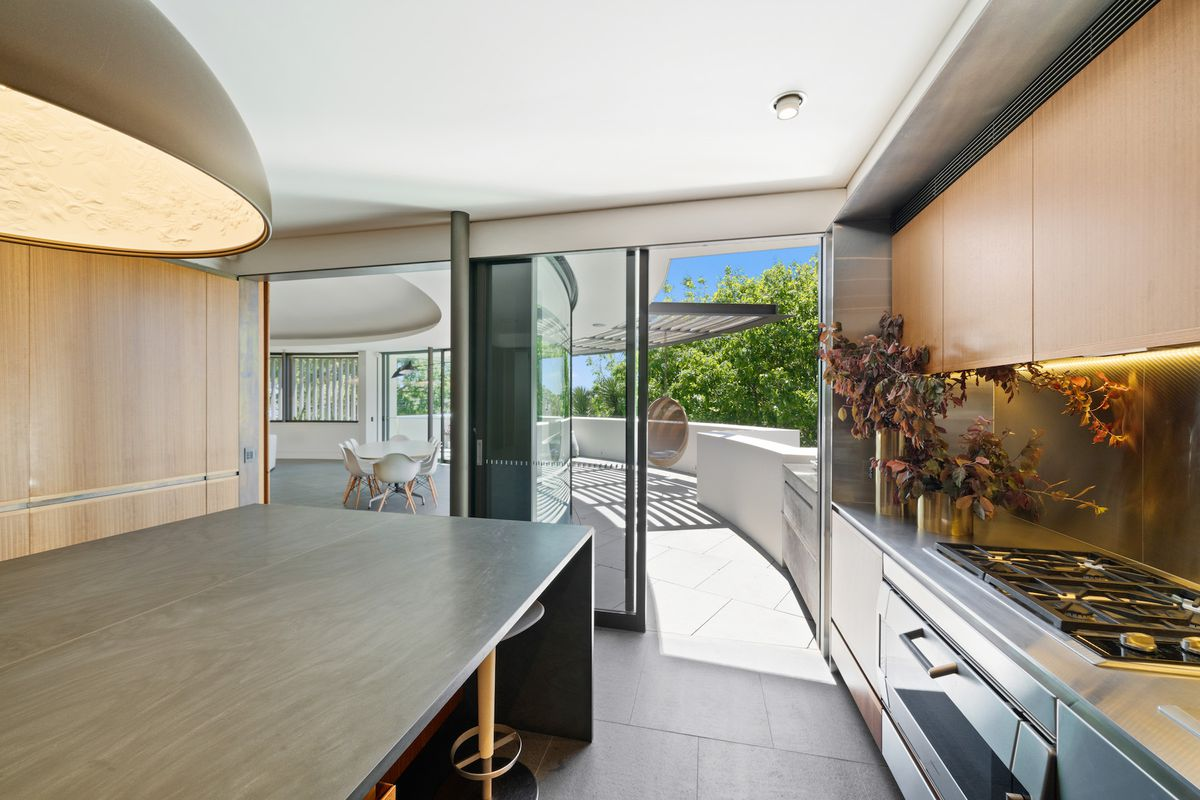 Modern kitchen that opens onto terrace.