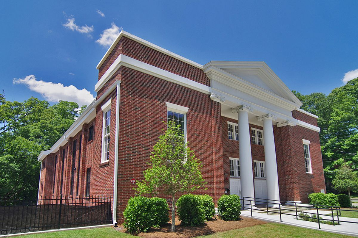 A two-story classical red brick church.