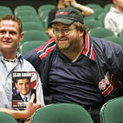 Bo Winder poses with Michael Moore look-alike Kenneth Brown as the two UVSC students wait for Sean Hannity to speak Monday before a capacity crowd.