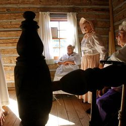 Linda Quitner, left, Raelou Elsberry, Dawn Warenski, Zoloma Goodall are members of the Daughters of the Utah Pioneers and helped in the restoration of a historic cabin in Santaquin.