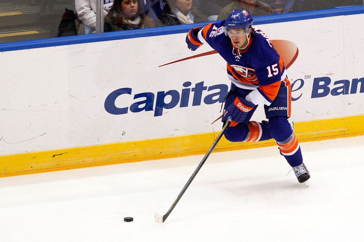 Mar. 29, 2012; Uniondale, NY, USA; New York Islanders right wing P.A. Parenteau (15) controls the puck during the second period against the Pittsburgh Penguins at Nassau Veterans Memorial Coliseum. Mandatory Credit: Debby Wong-US PRESSWIRE