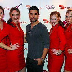Wilmer Valderrama and the Virgin America flight attendants in their Banana Republic-made uniforms