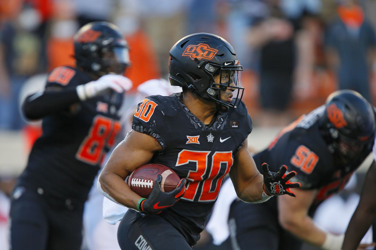 Running back Chuba Hubbard #30 of the Oklahoma State Cowboys runs for a six-yard gain against the Texas Longhorns near the end of the third quarter at Boone Pickens Stadium on October 31, 2020 in Stillwater, Oklahoma. Texas won 41-34 in overtime.