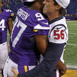 Aug 9, 2013; Minneapolis, MN, USA; Houston Texans inside linebacker Brian Cushing (56) talks with Minnesota Vikings defensive end Everson Griffen (97) following the game at the Metrodome. The Texans defeated the Vikings 27-13.