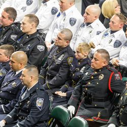 Law enforcement officers from across the nations listen during funeral services for Unified police officer Doug Barney at the Maverik Center in West Valley City on Monday, Jan. 25, 2016.