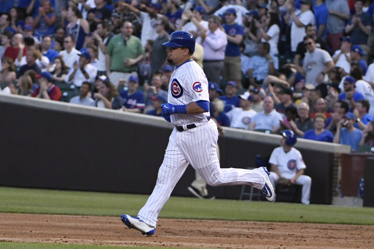 CHICAGO, IL - MAY 16: Kyle Schwarber #12 of the Chicago Cubs rounds the bases after hitting a home run against the Cincinnati Reds during the second inning on May 16, 2017 at Wrigley Field  in Chicago, Illinois. (Photo by David Banks/Getty Images)