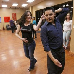 South Salt Lake Businesswoman of the Year Maria Ivanova gives some help to Alex Villalobos Tuesday, March 12, 2013, at her dance studio, DF Dance.