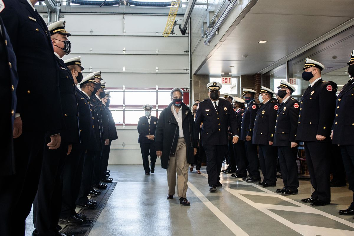 Mayor Lori Lightfoot, surrounded by members of the Chicago Fire Department, in the West Pullman neighborhood last week.