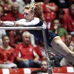 Utah State's Rebecca Holliday performs on the bars at the NCAA Salt Lake Regional. She was an individual qualifier.