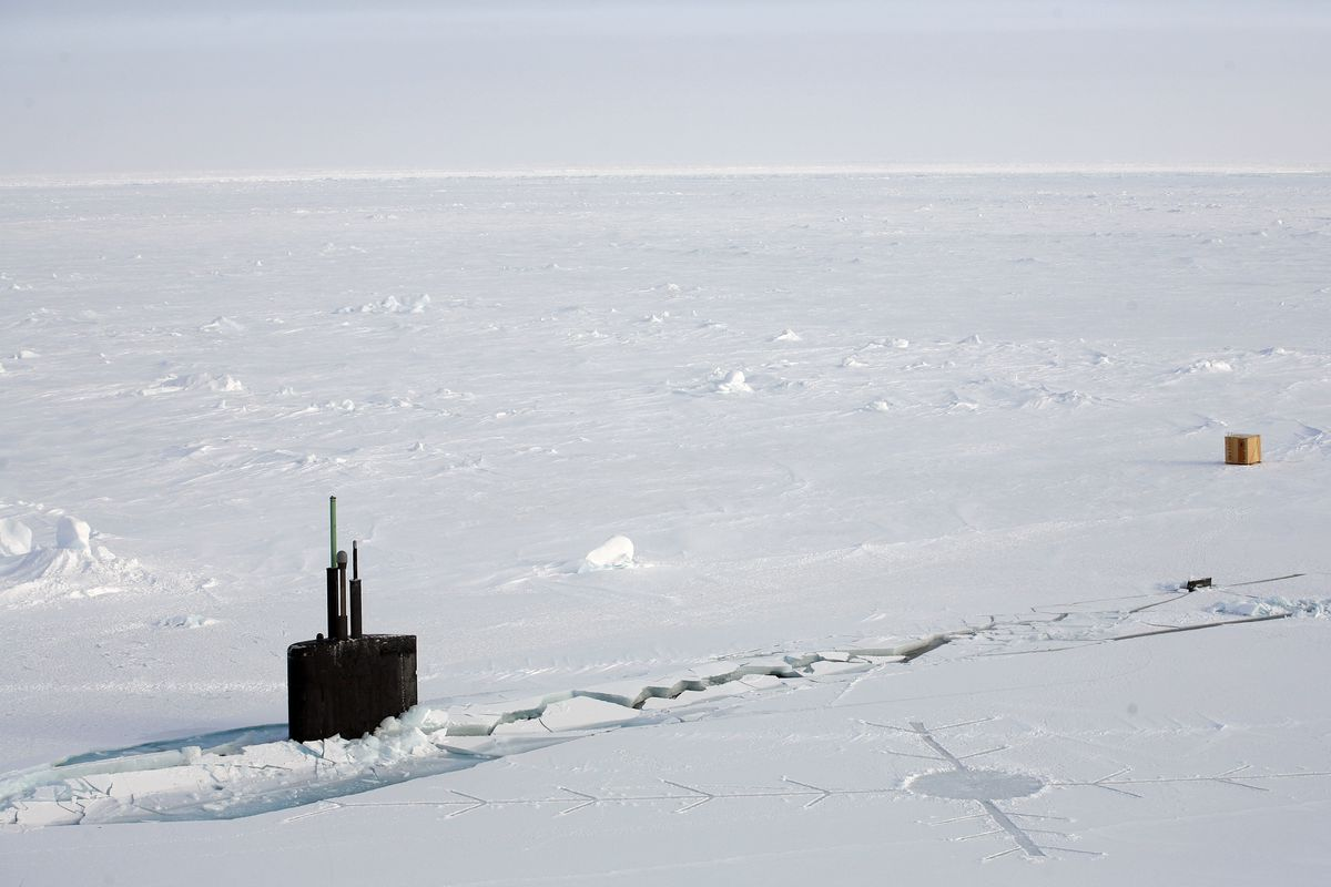 The United States Navy nuclear submarine USS Alexandria sits at ice level near its intended target