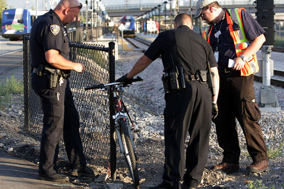 Salt Lake City police look at the bicycle involved after its rider was critically injured when he was pinned under a FrontRunner train Thursday near 200 South and 600 West.