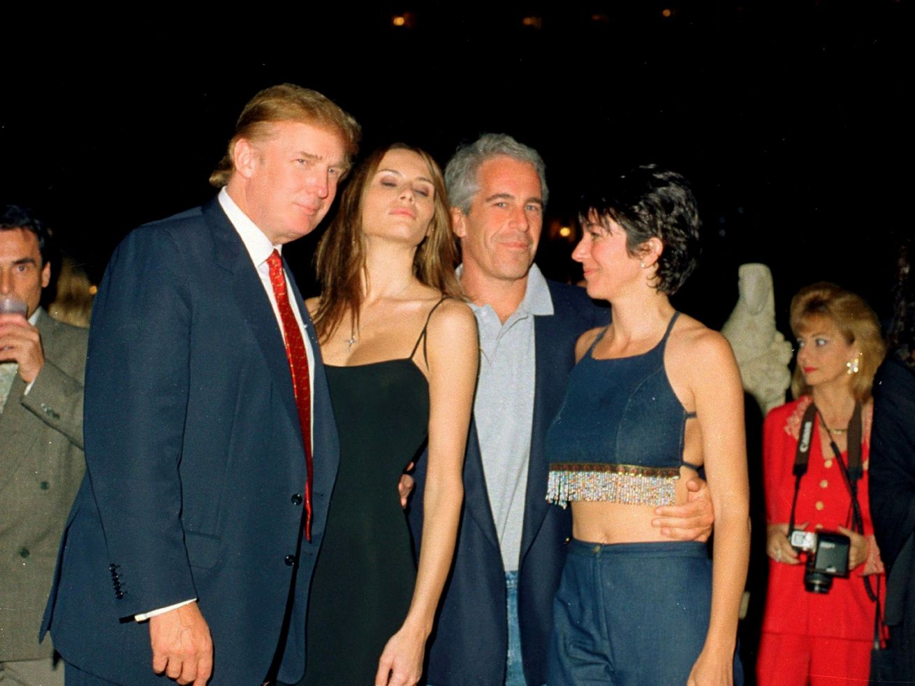 Jeffrey Epstein and his partner, Ghislaine Maxwell, with Donald and Melania Trump at Mar-a-Lago in 2000.